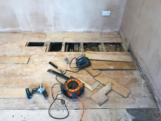 Pine floorboards subfoor repair, Tottenham